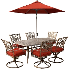 Hanover Traditions 7-Piece Dining Set in Red with Six Swivel Rockers, a 72 x 38 in. Cast-top Table, 9 Ft. Umbrella and Umbrella Stand - TRADDN7PCSW6-SU-R