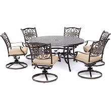 Hanover Traditions 7-Piece Dining Set in Tan with a 60 In. Round Cast-top Table and Six Swivel Rockers - TRADDN7PCSWRD6