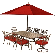 Hanover Traditions 9-Piece Dining Set in Red with an Extra-Long Cast-Top Dining Table, 11 Ft. Table Umbrella, and Umbrella Stand - TRADDN9PCSW2-SU-R