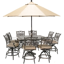 Hanover Traditions 9-Piece High-Dining Set in Natural Oat with 8 Swivel Chairs, a 60 In. Square Cast-Top Table, Umbrella and Stand, TRADDN9PCBRSQ-SU-T