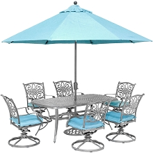 Hanover Traditions 7-Piece Gray Patio Dining Set with 6 Swivel Rockers, Blue Cushions, Cast-Top Dining Table, and Umbrella with Stand, TRADDNG7PCSW6-SU-B