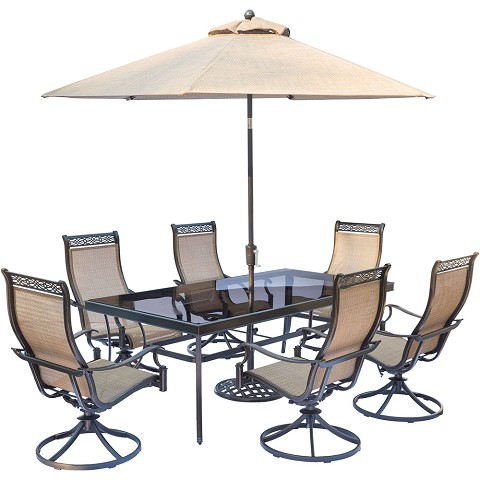 "Hanover Monaco 7-Piece Dining Set with 6 Sling Swivel Rockers, a 42"" x 84"" Glass-Top Dining Table, and a 9 Ft. Umbrella with Stand - MONDN7PCSWG-SU"