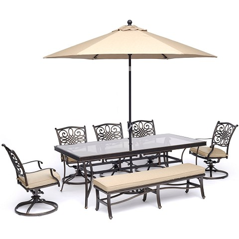 "Hanover Traditions 7-Piece Dining Set in Tan with 5 Swivel Rockers, Bench, 42""x84"" Glass-Top Table, and 11 Ft. Umbrella with Stand - TRADDN7PCSW5GBN-SU-T"