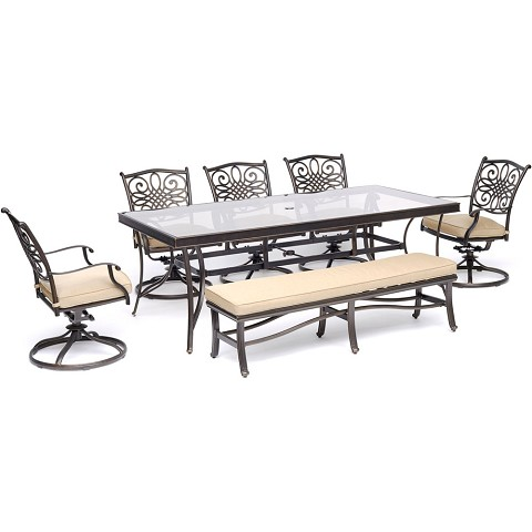 "Hanover Traditions 7-Piece Outdoor Dining Set in Tan with 5 Swivel Rockers, a Cushioned Bench, and a 42"" x 84"" Glass-Top Table - TRADDN7PCSW5GBN-TAN"