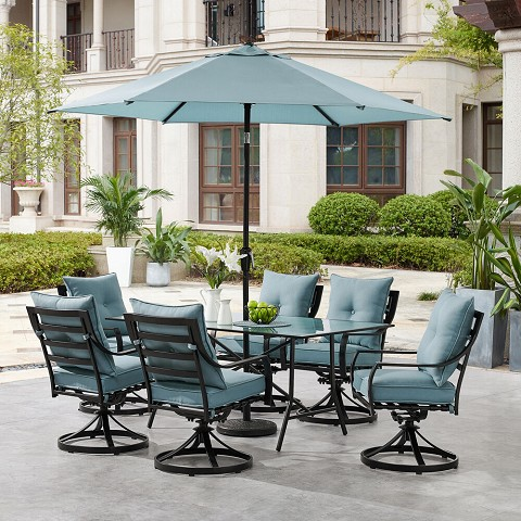 "Hanover Lavallette 7-Piece Dining Set in Ocean Blue with 6 Swivel Rockers, 66"" x 38"" Glass-Top Table, Umbrella, and Base, LAVDN7PCSW-BLU-SU"